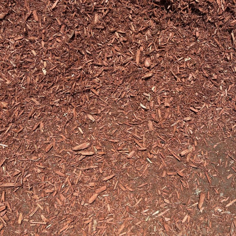 Pictured is our Cedar Mulch. It consists of bright red wood chips.