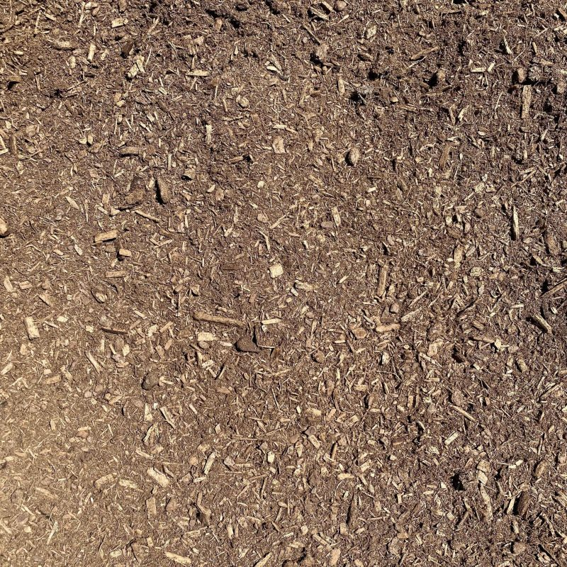 Pictured is our pine mulch from our garden center. It is a medium brown color.