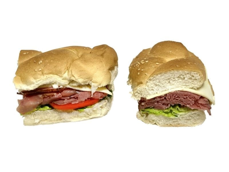 Pictured is a roast beef sandwich with cheese and lettuce on a braided roll!