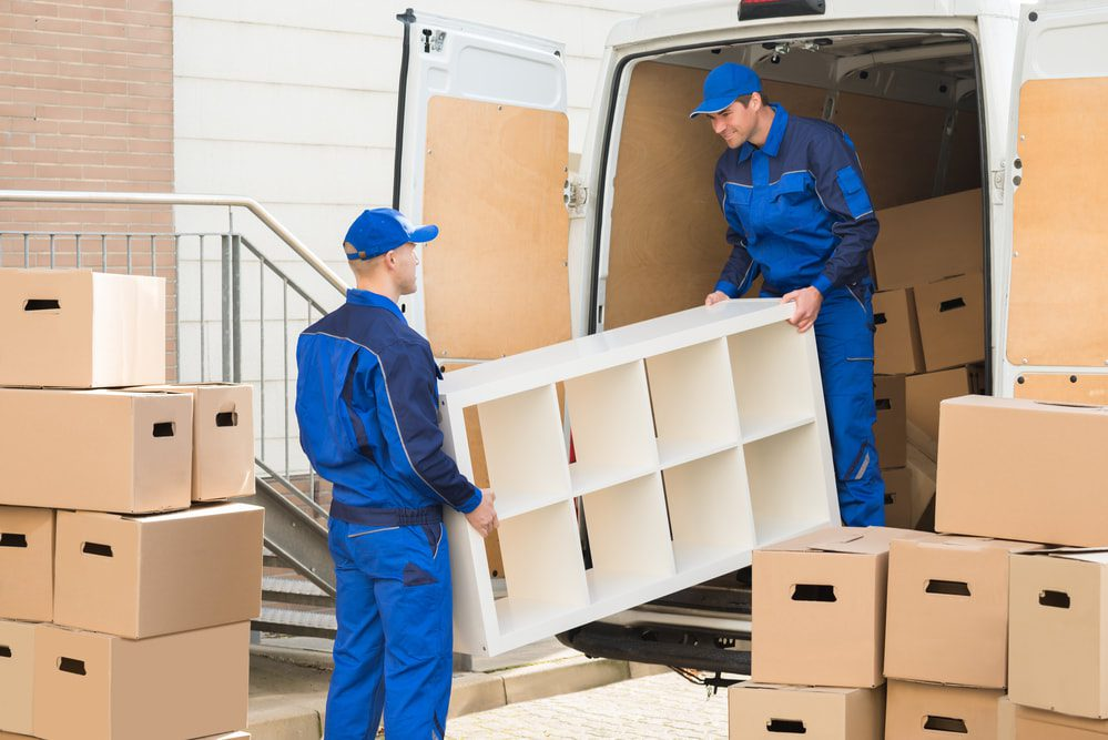 Commercial movers moving a shelving system