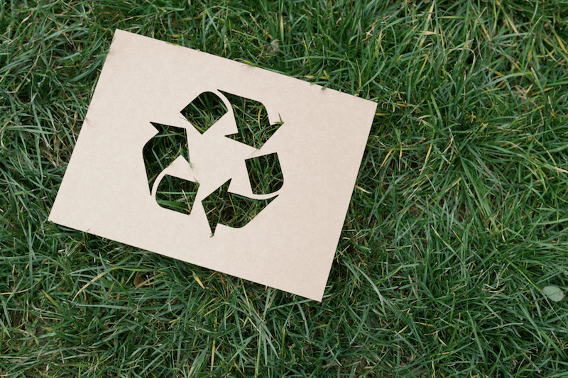 Recycling symbol on the grass