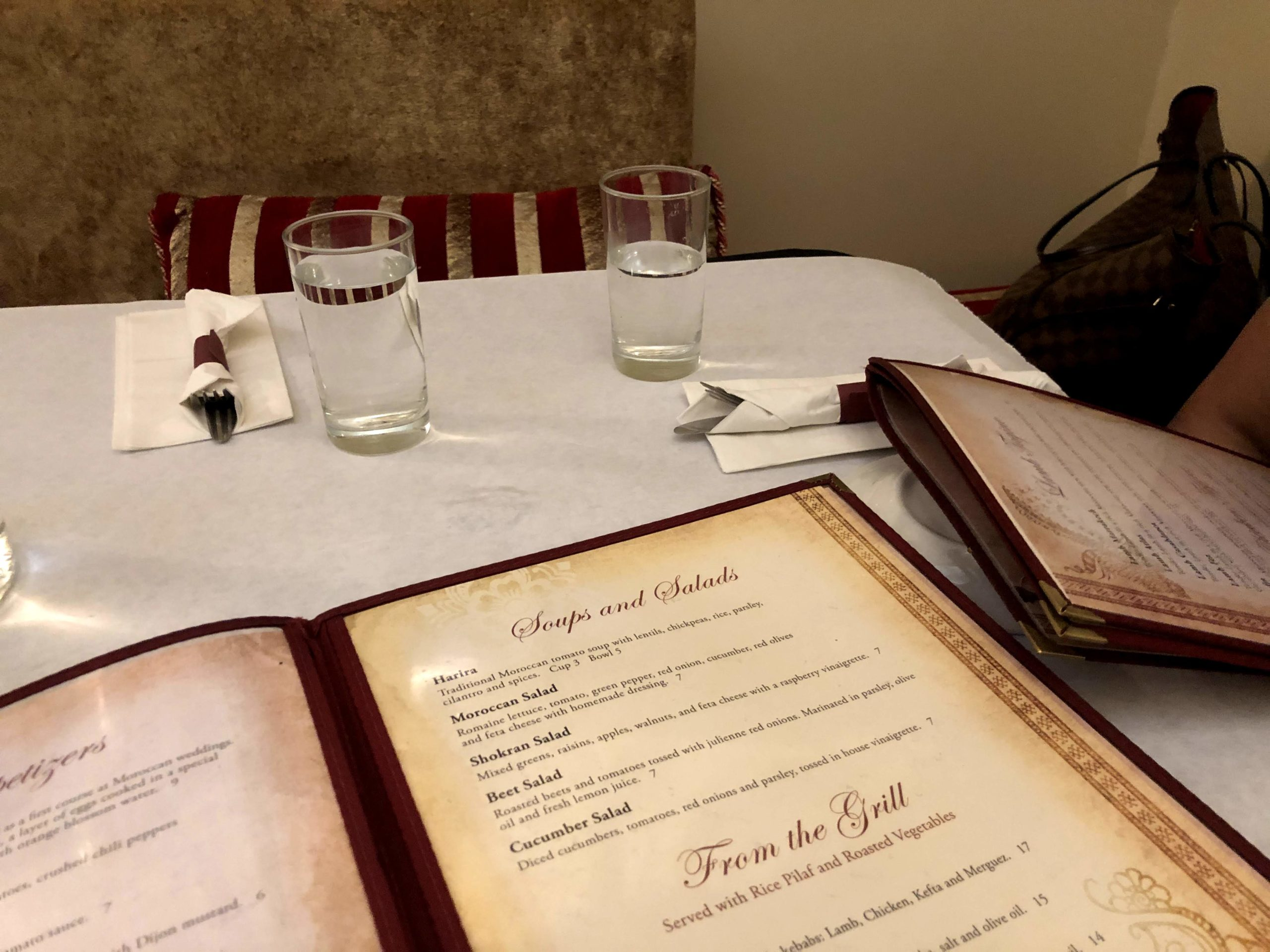 Restaurant with table and menus open