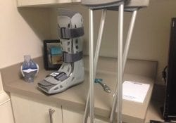 Boot and crutches leaning against exam table