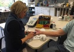 Occupational therapist working on a patient's injured hand