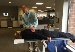 Physical therapist performing therapy on a patient's back