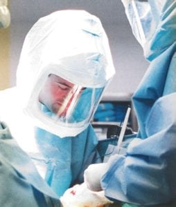 Dr. Alessandro performing joint replacement surgery